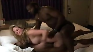 Sexy babe takes black dicks in her holes at the same time